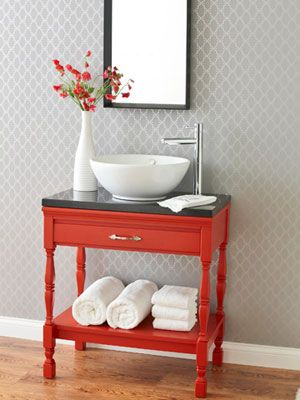 Striking red table goes so well with clean white and a grey wallpapered wall - Modern and Fierce!! ♥ ♥ ♥ #red #bathroom
