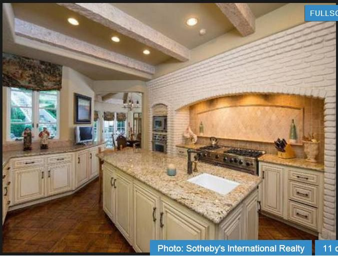I like the lighter granite countertops with the light cabinets.