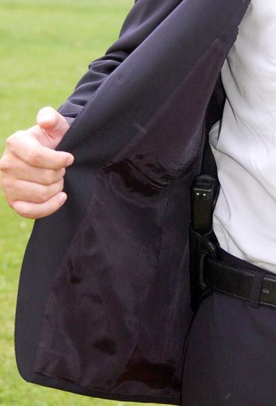 concealed carry style blazer handgun showing jacket open