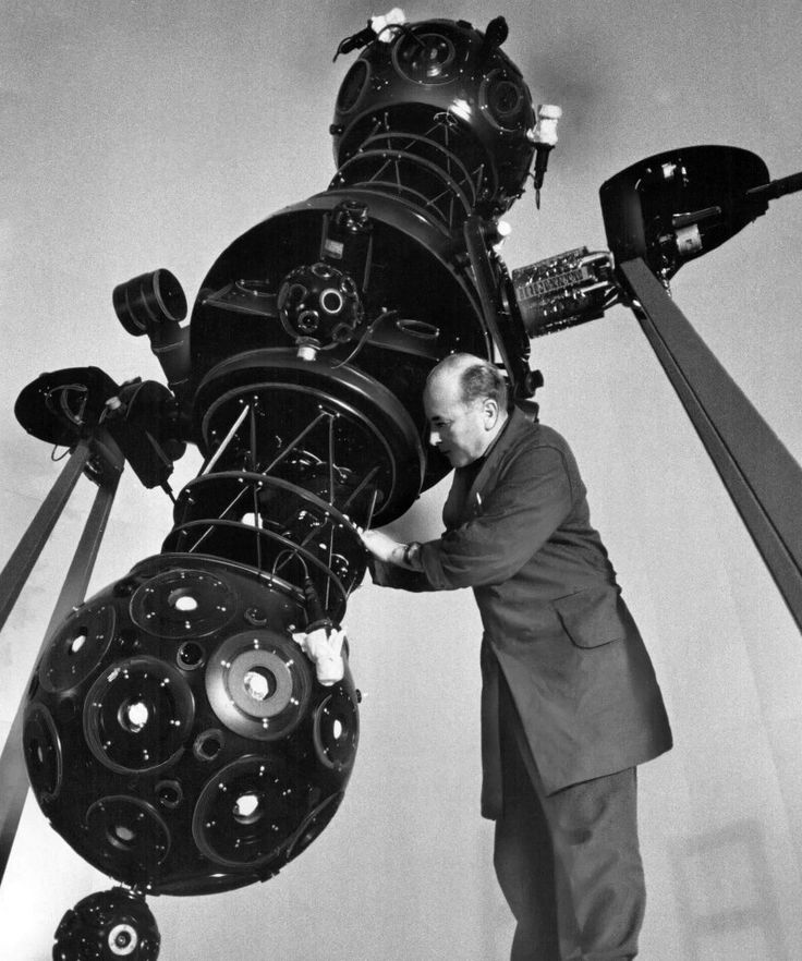 """1968: """"Bringing us the stars: Vogel Gerhard, in charge of the Zeiss planetarium projector, makes adjustments to the one he is installing at the McLaughlin Planetarium, just south of the Royal Ontario Museum."""" Photo by Jeff Goode. - Courtesy of Toronto Public Library & the Toronto Star Archives."""