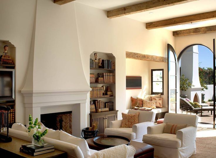 Mediterranean Style Decor With Fireplace And White Seating And Ottoman As Coffee Table And Built In Bookcases And Arched Glass Doors : Using Mediterranean Decorating Style For The Home , Home Design and Decor