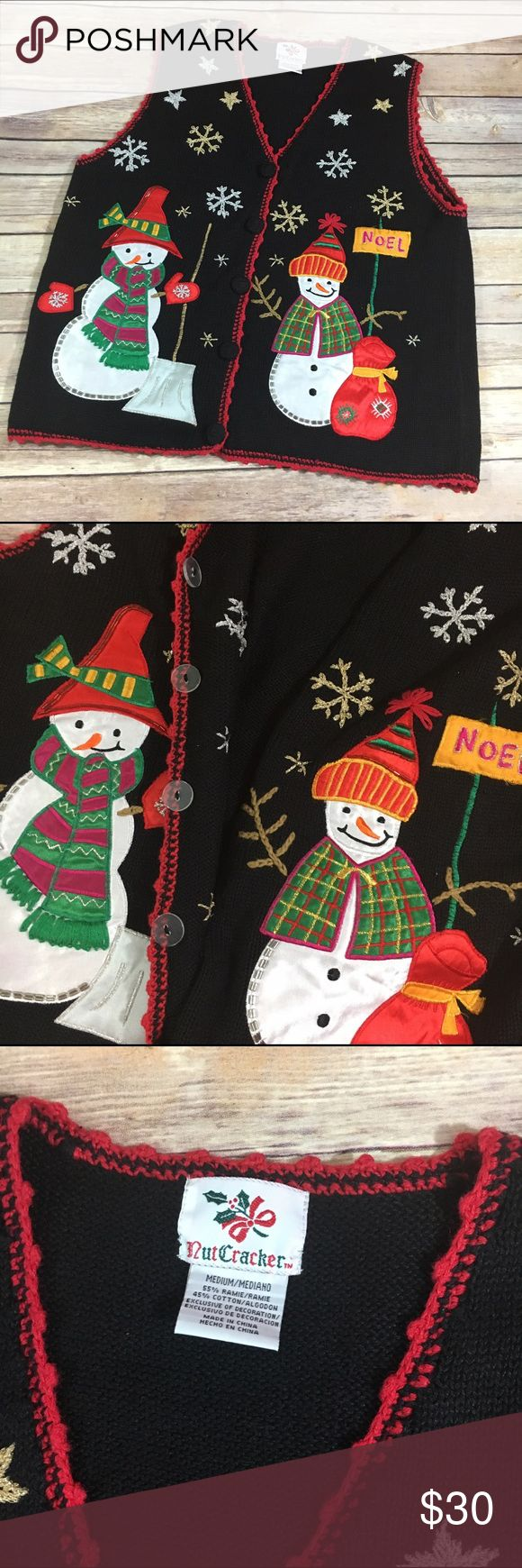 "NutCracker Ugly Christmas Sweater Vest Snowmen M NutCracker Ugly Christmas Sweater Vest Snowmen M  Groovy Christmas sweater vest for your ugly Christmas sweater party or just being ironic.  Or giving to your grandma to add to her collection!  Anything you want to do with this super cool sweater.  Buttons inside, not with the decorative buttons.  24.5"" long 20"" p to p NutCracker Sweaters"