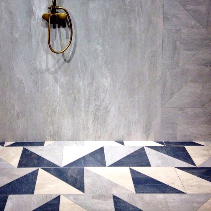 After 3 weeks of refurbishment works we're almost ready to unveil our new displays and room sets in our central London showroom. Expect beautiful XL format porcelain stone tiles and custom pattern tiles #interiordesign #interiordesigninspiration #tiles #design #shape #pattern #surfacedesign #floortiles #walltiles #triangle #triangletiles #interiors #homedecor #decorinspiration #texture #flooring #flooringdesign #bathroomdesign