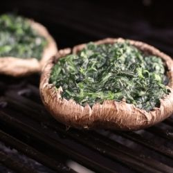 I Love Portabella mushrooms as well as Hot Spinach Cheese.  These combined would make a super Appetizer! Probably Shitake Mushrooms would be even more interesting!    Grilled cheesy spinach stuffed portabellas, low calorie, healthy, light, delicious!