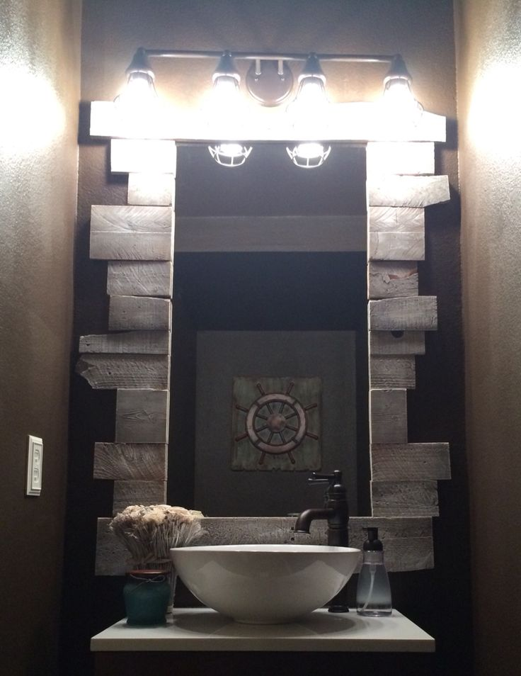 Our weekend (or 2) project. Paint: Sarsparilla by Olympic Vanity:  Cromlee by Style Selections Lighting: Bayley by Kichler Mirror Frame: Reclaimed pallet wood custom cut Dry brushed white Attached with Loctite All-Purpose Interior Construction Adhesive Decor: from At Home