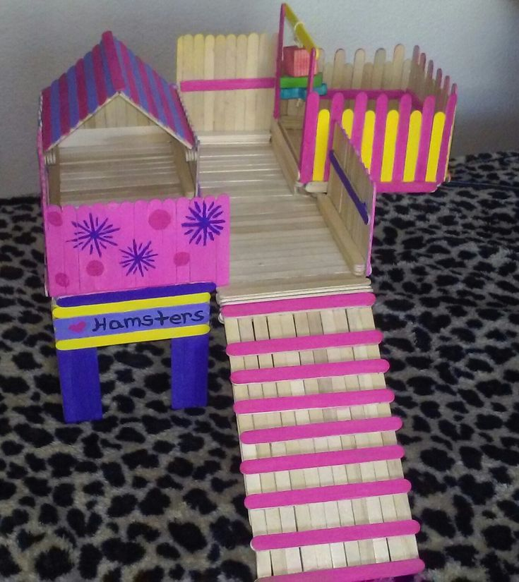 A popsicle stick house I just finished making for my hamster Honey ❤ and I used non-toxic paint (:
