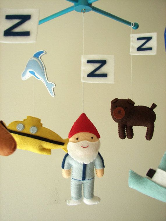 Life Aquatic with Steve Zissou mobile is perfect for the smallest fan in your house. You will love all the handmade accents and attention to detail. This features Steve as well as his submarine, and the 3-legged dog. Your little one will love this amazing handmade gift.