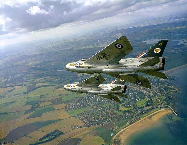 English Electric Lightning F.3s of No. 74 Squadron based at RAF Leuchars, Fife, are seen in flight over nearby St Andrews in 1964