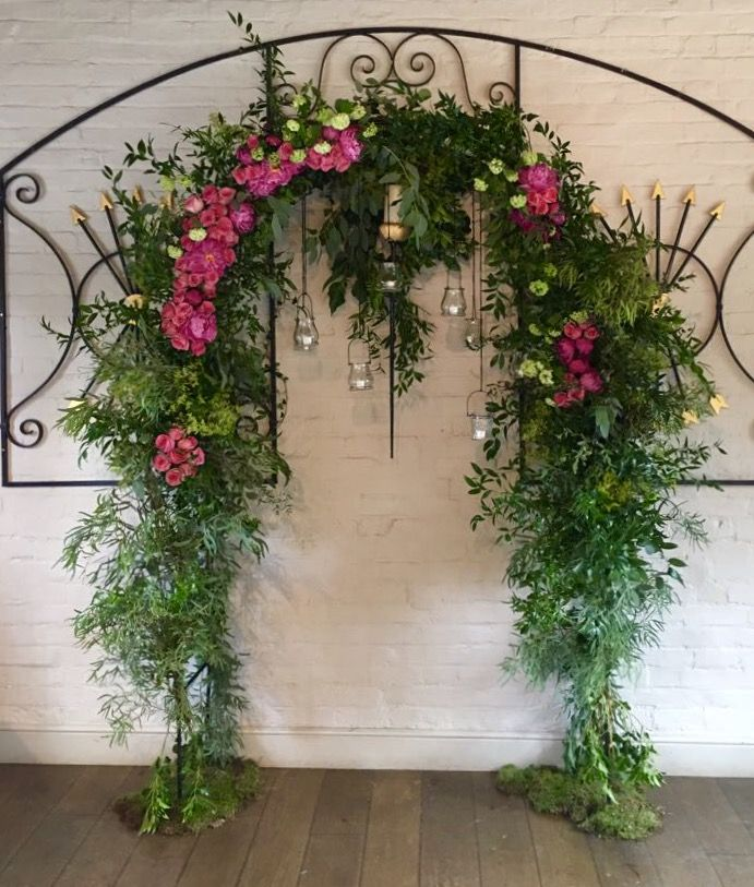 Floral wedding arch at the 5 Arrows Hotel, Waddesdon using peonies, roses & lots of lush foliage