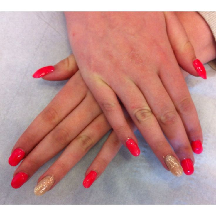 A set of acrylics with coloured gel polish and glittered ring fingers