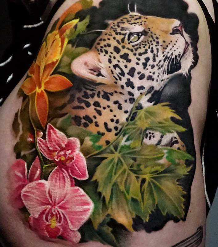 Flowers and Jaguar Tattoo by Khan Tattoo