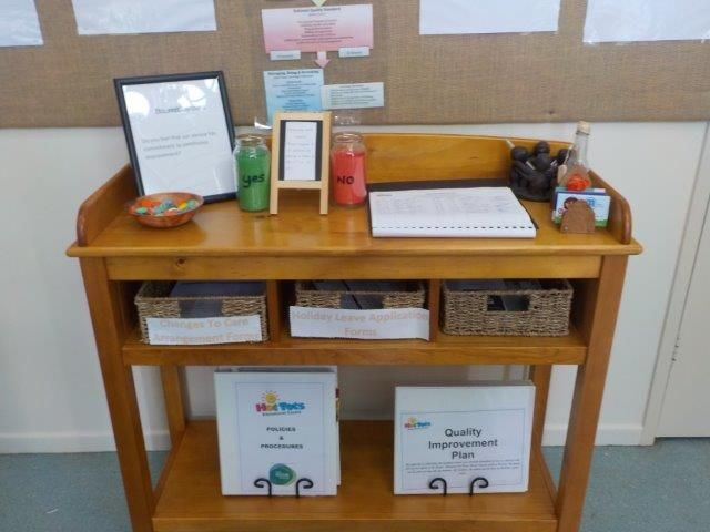 Hot Tots Educational Centre display their QIP for families.