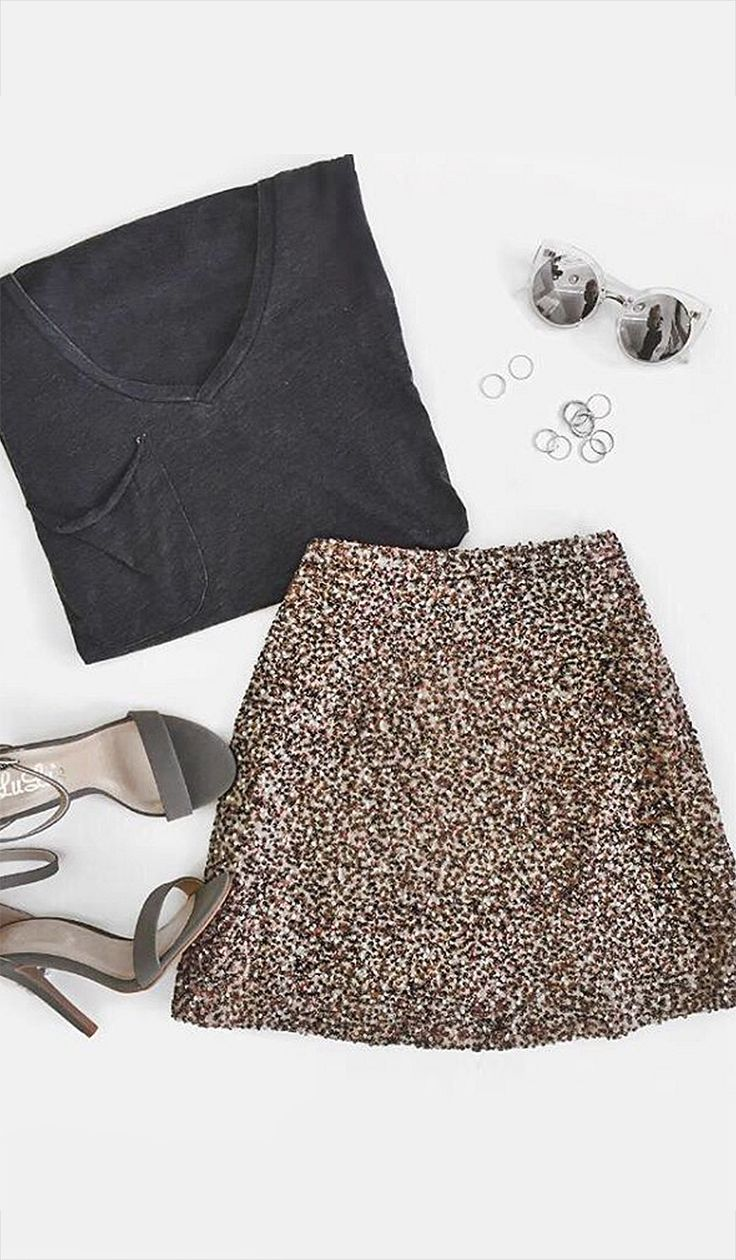 Woven taupe fabric decorated with shimmering bronze and silver sequins shapes a chic, sheath skirt with a high, fitted waistline, and leg-baring length.  #lovelulus