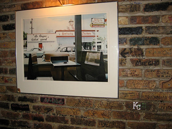 Finger Lickin Good - KFC - Medici Restaurant, Hyde Park, Chicago - a great picture within a picture for a restaurant to have on the wall, along with the fine Medici graffiti.