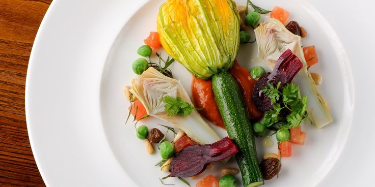 Stuffed courgette flowers make a great, healthy starter. In this stuffed courgette flowers recipe, Dominic Chapman stuffs the flower with creamy ricotta, pine nuts and sultanas