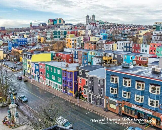 St. John's, NFLD's brightly coloured row houses are spread throughout the city. The vibrant facades 1st sprung up in the late 1970s, as a way of injecting new life into a declining downtown.