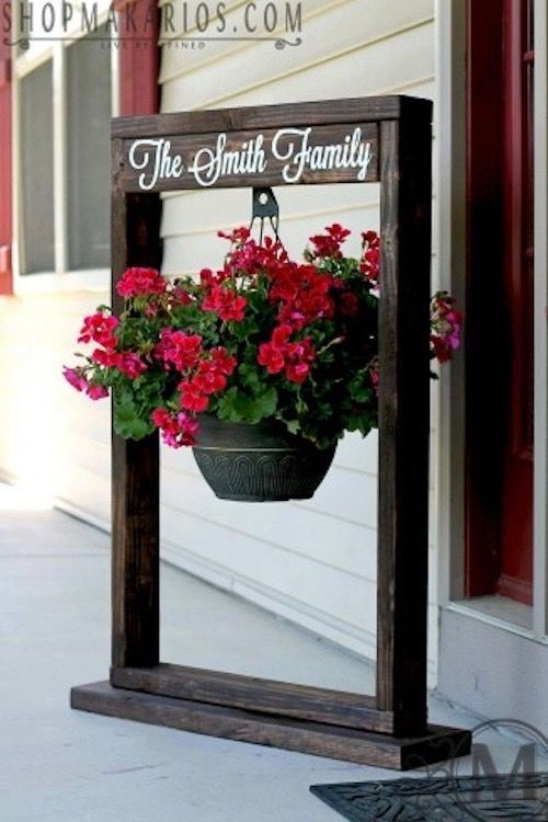 Hanging plant garden sign. LOVE!