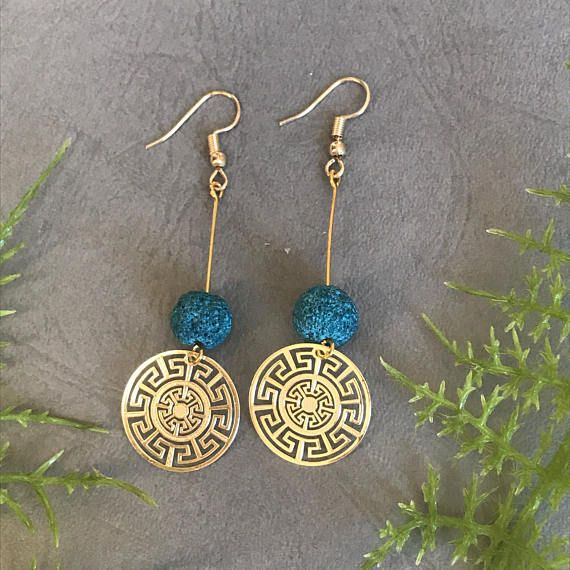 Handmade, long, beaded earrings with different stones to choose from and gold plated meanders at the very end. Different options: aquamarine/blue lava stone (the one in the pictures), dark blue lava stones (not in the pictures), white pearls, black lava stones, premium purple howlite