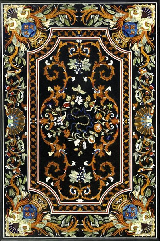 An inlaid marble and hardstone table top inlaid with foliate rinceaux, the corners inlaid with stylised dolphins flanking a crown. height 46 1/2 in.; width 70 1/2 in. 118 cm; 170 cm