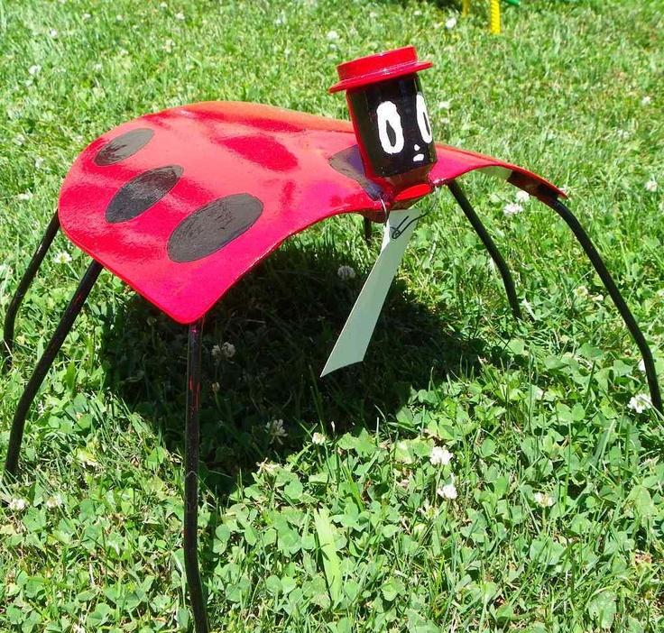 recycled tools to yard art