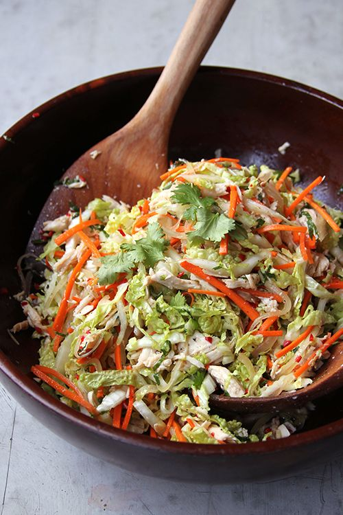 INGREDIENTS 2 fresh hot red chiles (Thai or serrano) 3 cloves garlic, minced 2 tbsp. sugar 1 tbsp. rice wine vinegar 3 tbsp. fresh lime juice 3 tbsp. Vietnamese fish sauce (nuó'c mam) 3 tbsp. vegetable oil 1 small onion, thinly sliced 2 cups shredded cooked chicken 4 cups shredded napa cabbage 2 medium carrots, julienned ½ cup roughly chopped mint Freshly ground black pepper Cilantro, for garnish