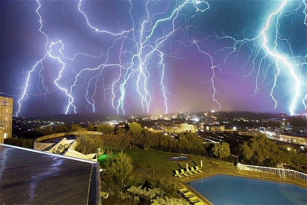 A multiple exposure photograph shows lightning striking above Maseru, capital of Lesotho