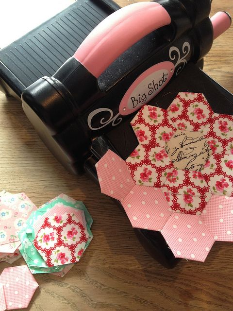 use a SIZZIX Big Shot Machine for cutting out squares from my scraps or strips and also hexagons.