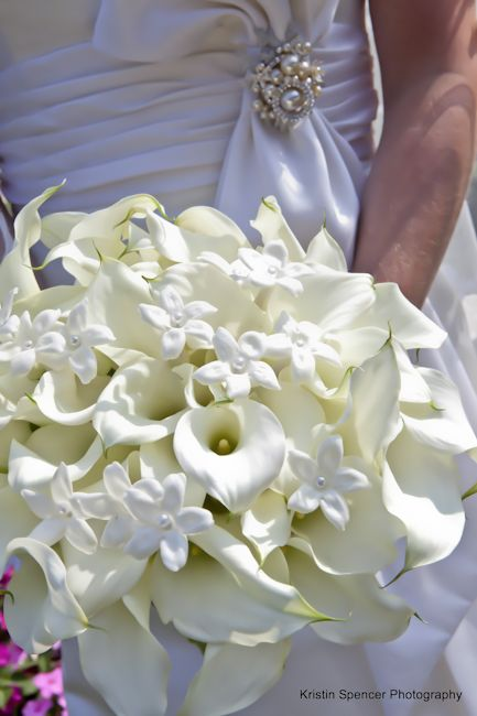 Stoneblossom Florals' White Calla Lilly and Stephanotis Bouquet ~ Stephanotis symbolizes happiness in marriage. I'd like it if it was in pretty colors
