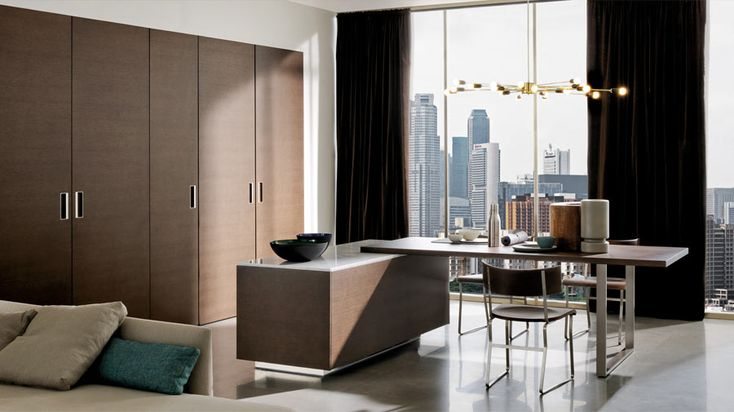 The current trend is for an open-plan kitchen-living room. Built-in cupbards and breakfast bar; this makes for an elegant space.