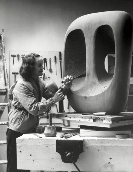 Barbara Hepworth in the Palais studio at work on the wood carving Hollow Form with White Interior 1963 Photograph: Val Wilmer