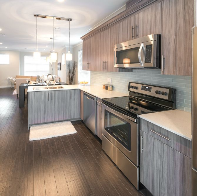 Small L-shaped kitchen in open concept townhome.