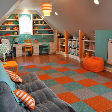 Sloped room over garage. Love the orange short walls that separate the book shelves!