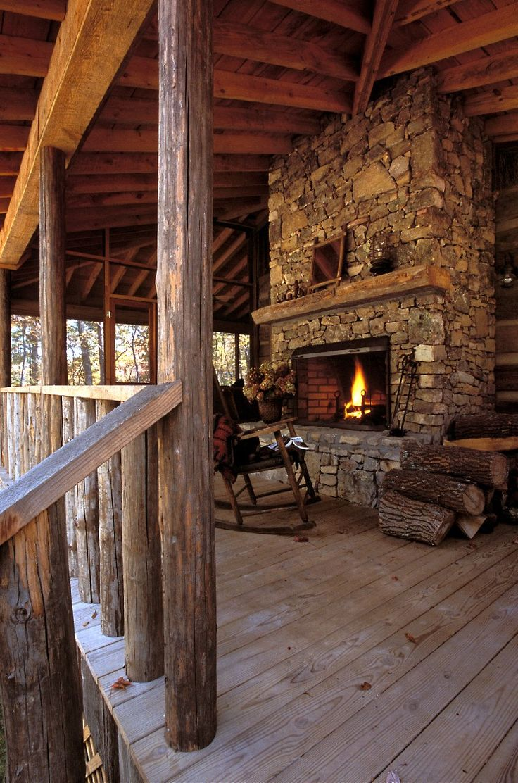 Cabin bedroom fireplace - Rustic Cabin Porch With Fireplace