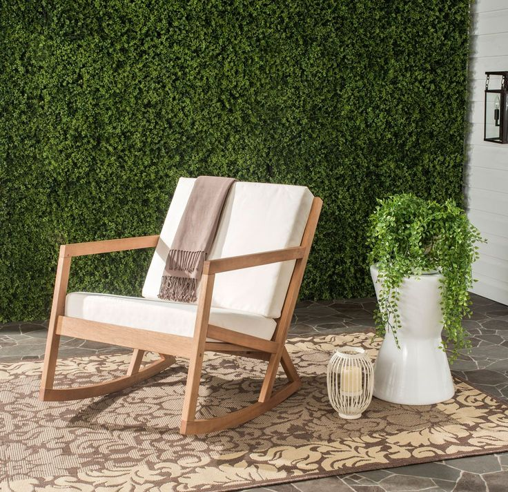 Contemporary with a nod to hand-crafted Shaker individuality, this elegant  outdoor rocking chair
