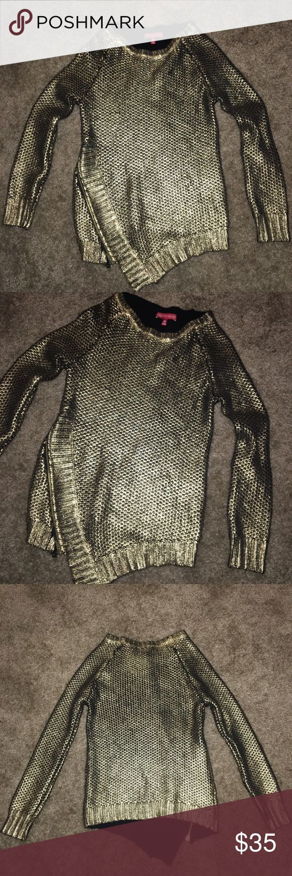Saks Fifth Avenue Gold Metallic Sweater Small Worn once with no signs of wear.  Front right bottom zipper with point.  Sweater was made with some black spots throughout, some are prominent on upper front and back, see last two pics.  Sleeve length is 24 inches measured from neck, 24 inches from top to bottom. Saks Fifth Avenue Sweaters Crew & Scoop Necks