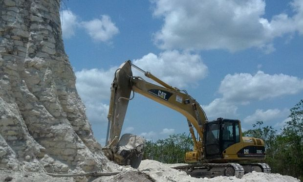 Mayan pyramid bulldozed by road construction firm Belize pyramid dating back at least 2,300 years is destroyed by firm to extract crushed rock for road-building project. Belize 2013.  A digger claws away at the sloping sides of the Mayan pyramid in Belize