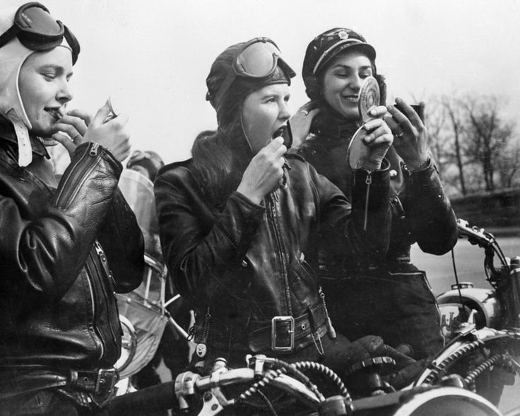 February 1950: Bikers Marian Willgoes, Joan Nimlo and Gloria Crane reapply their make up during a meeting of their all female motorbike club n Queens, New York. (Photo by Keystone Features/Getty Images)