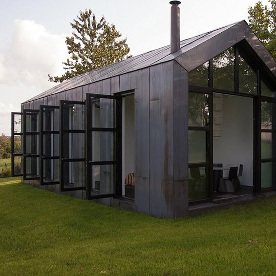 In western Germany, Weidingen, the architecture firm AXT Architekten has designed this small guest house. Embodying the architectural codes of the homes in the area, this small volume of one piece is divided by walls li ...