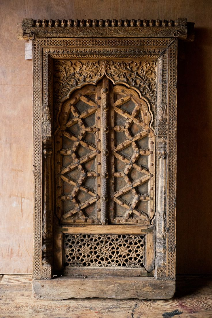 This Antique Ornately Carved Wooden Window is an architectural work of art and a beautiful piece of history to incorporate into your home or establishment. Build it into the wall between rooms, or sim