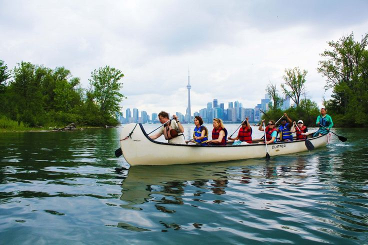 Toronto Islands campfire. Group activity. Canoe tour and campfire on the islands. Youth group enjoys the best view of Toronto city skyline. Paddle to the islands in a Voyageur Canoe.