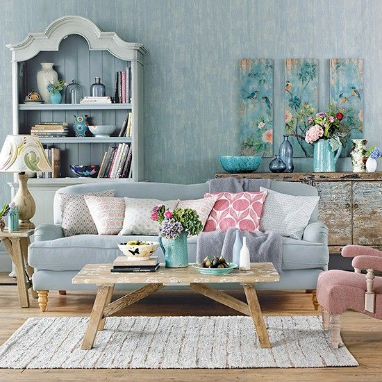 Shabby chic blue living room with wooden floor