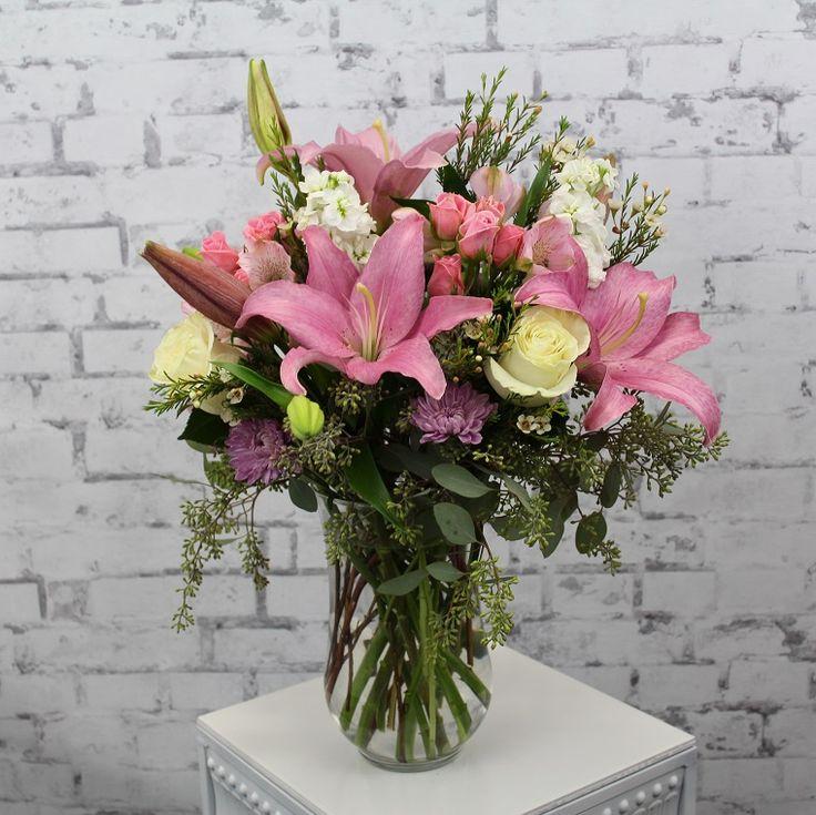 composizioni di fiori con lilium, orchidee e rose