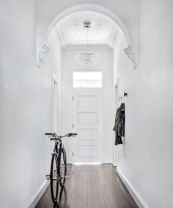 Although renovations have given the home a minimalist look, its ornate architectural features mean it also retains much of its original Victorian charm.: [object Object]