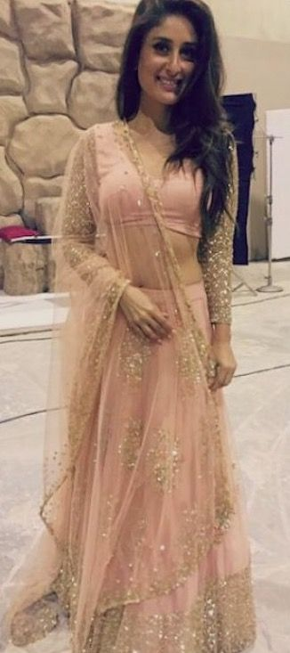 Kareena Kapoor in a pretty pink blush lehenga, blouse and dupatta. Indian Bollywood fashion.