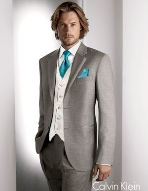 Bright teal tie and matching pocket square paired with stone gray suit and champagne color vest.
