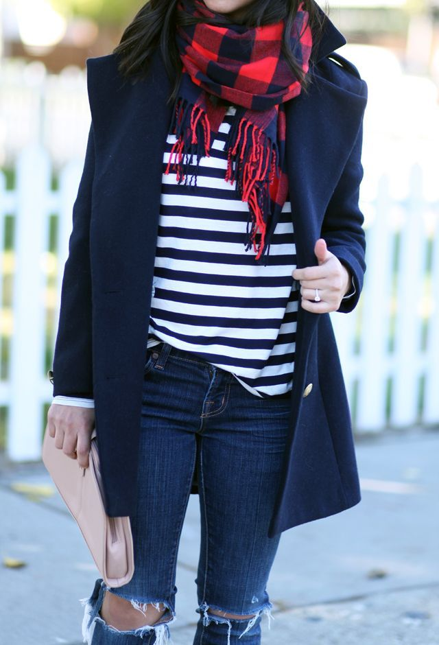 Basic Outfit. You can copy it with what you have at home. She is wearing a navy striped tee with a blue and red scarf, broken jeans and a gorgeous winter blue coat.