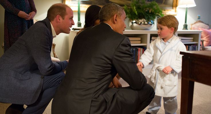 President Barack Obama, Prince William and First Lady Michelle Obama play with Prince George at Kensington Palace in London on April 22.   (Getty)