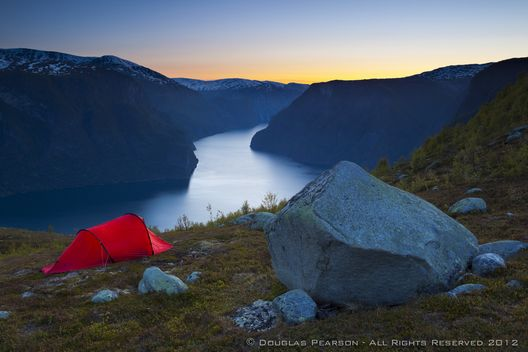 Hikers set down for the night in the dramatic Aurlands Fjord, Sogn og Fjordane, Norway