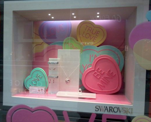 Oversized candy hearts are the perfect display prop for selling jewelry around Valentine's Day