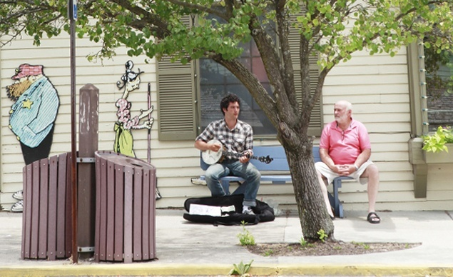 A local musician playing on the main drag in Nashville Ind.  (Whitney Tressel) From: Coolest Small Towns 2012. Click on the photo to nominate your favorite small town for 2014's contest!: Local Musician, Towns 2012, Small Towns, Photo